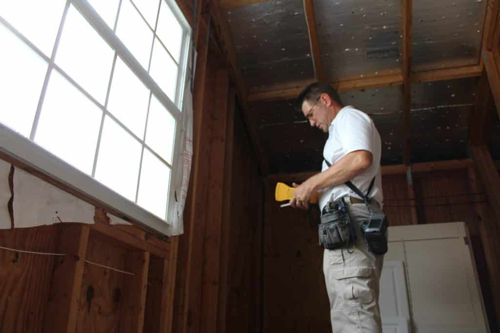 home inspector doing wind mitigation in attic